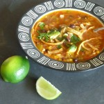 Tortilla soup with cilantro, avocado and lime juice